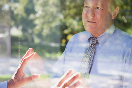 inner strength: Man looking at his reflection Stock Photo