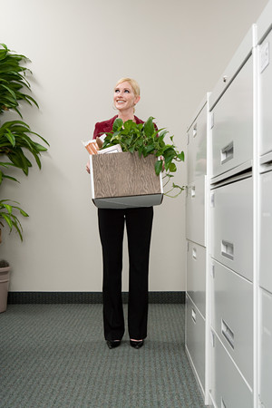 moving office: Woman moving office Stock Photo