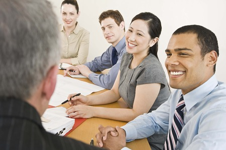 chinese american ethnicity: Five businesspeople in a meeting