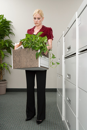 Woman with box of belongings Stock Photo
