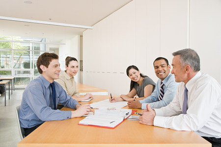 one people: Five businesspeople in a meeting