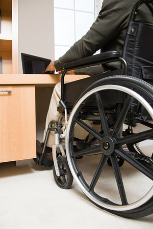 overcoming adversity: Rear view of a disabled man in a wheelchair