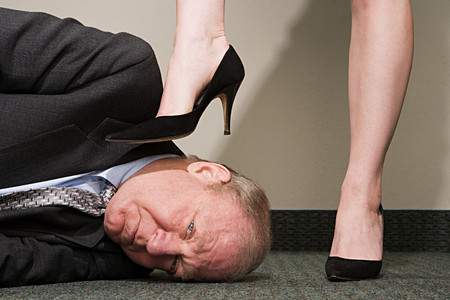 stepping on: Woman dominating businessman