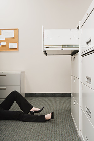 filing: Woman lying by filing cabinet