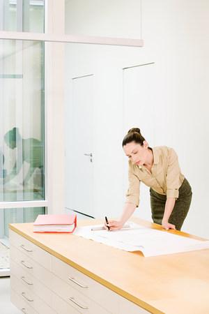 architect drawing: Female architect drawing Stock Photo
