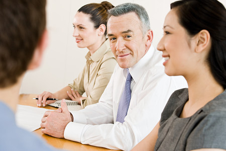chinese american ethnicity: Four business colleagues in a meeting