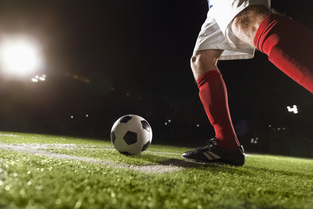 corner kick soccer: Soccer player making a corner kick