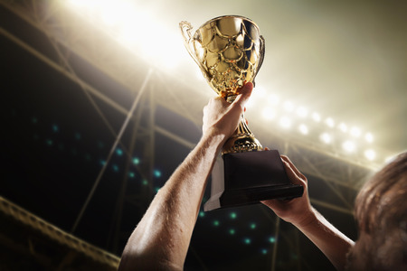 Athlete holding trophy cup