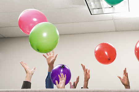 concealment: Office workers playing with balloons Stock Photo