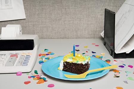 eating cake: Birthday cake on an office desk
