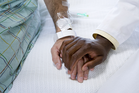 human source: Doctor holding patients hand
