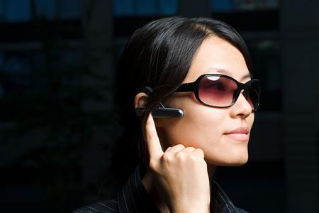 Woman using headset Фото со стока