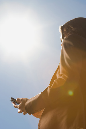 handheld: Person using handheld computer