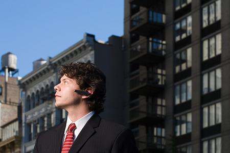 Businessman using headset Фото со стока