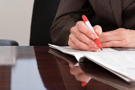 broadsheet newspaper: Person writing on newspaper Stock Photo