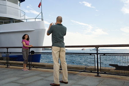 Man photographing woman