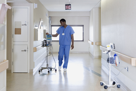 Hospital worker with iv drip