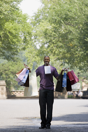 Man holding lots of bags