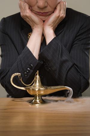 genie woman: Woman watching a genie lamp Stock Photo