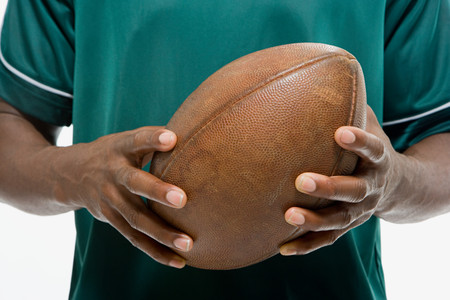 image source: Man holding american football