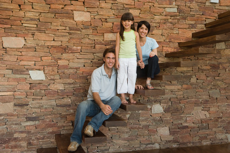 Portrait of a family on the steps Фото со стока