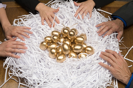eggs: Colleagues around a nest of gold eggs