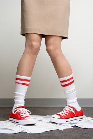 nonconformity: Female office worker wearing baseball boots