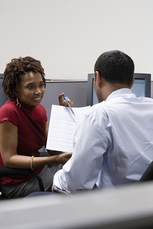 Woman helping colleague with form