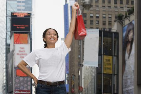 Woman holding shopping bag Фото со стока - 102144722