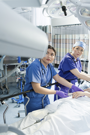 Surgeons with patient Stock Photo
