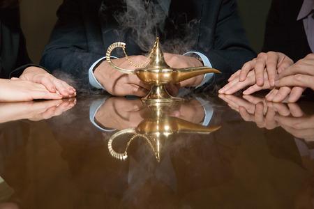 genie woman: Colleagues around a smoking genie lamp