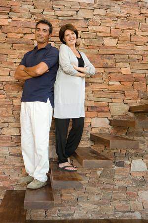 Couple standing on steps Фото со стока