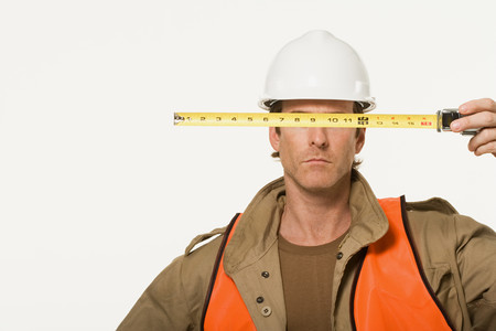 image source: Portrait of a construction worker Stock Photo