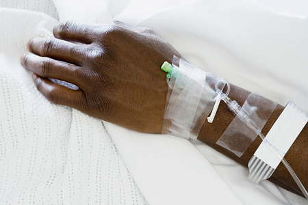african ethnicity: Arm of patient with drip
