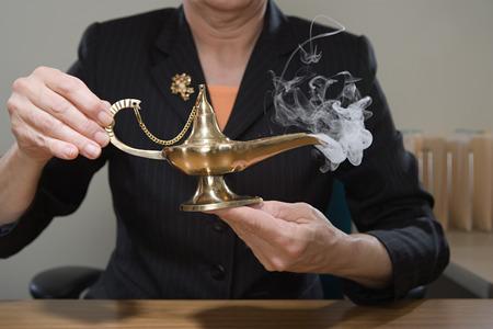 genie lamp: Woman holding genie lamp