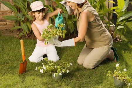 Girl and grandmother gardening Фото со стока - 99345260