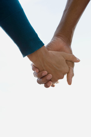 male hands: Couple holding hands