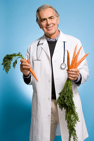 Doctor holding carrots