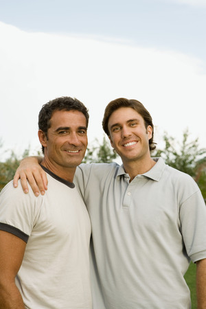 Two smiling men outdoors