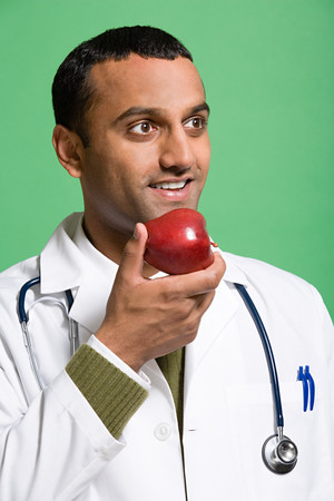 Doctor eating an apple