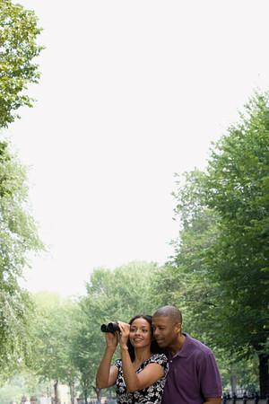 A happy couple looking through binoculars Фото со стока - 99121491