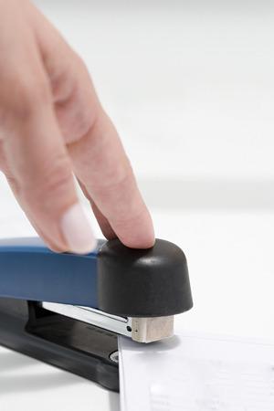 Person using stapler