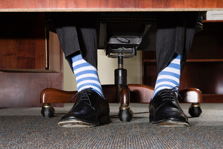 image source: Businessman with striped socks Stock Photo