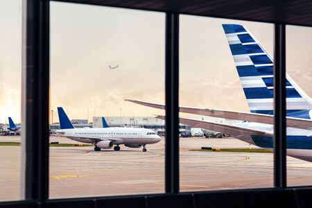 View of airplane fuselage tail through window at airport Фото со стока - 140842919