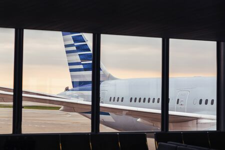 View of airplane fuselage tail through window at airport Фото со стока - 140842920
