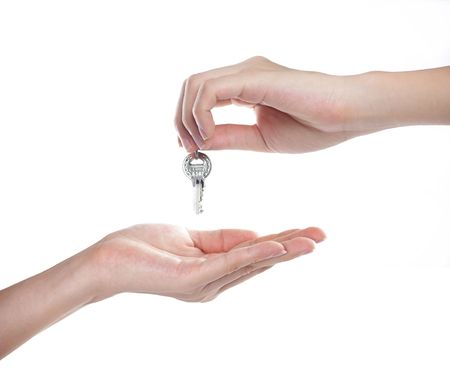 escrow: Hands and key isolated on white background  Stock Photo