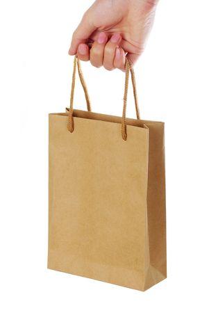 Mano sosteniendo que comercial plantea, en un fondo blanco.  Foto de archivo