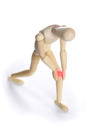 wooden figure: Pain concept - person holding his knee