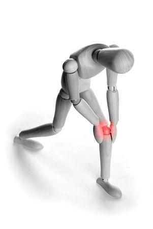 Concetto di dolore - persona che detiene il suo ginocchio  Archivio Fotografico