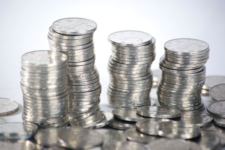 pound coins: Stacks and Piles of Coins.